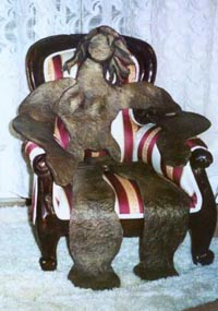 NAKED LADY 1 ON BALI CHAIR bronze, 22″ x 18″ x 19″